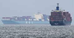 FILE - In this April 21, 2014 file photo, container ship Josco View, of Hong Kong, right, and Panama's container ship Mol Earnest sail through a port in Yokohama, southwest of Tokyo. Japan's trade deficit narrowed in April as exports grew faster than imports following an increase in the sales tax that is expected to dampen demand for some time. The 808.9 billion yen ($8 billion) deficit in April, according to preliminary figures released Wednesday, May 21, 2014 by the Ministry of Finance, compared with a gap of 877.4 billion yen a year earlier and with a 1.7 trillion yen deficit in March. (AP Photo/Koji Sasahara, File)