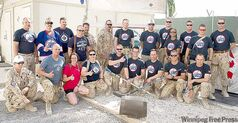 Members of the transition task force winding up the Afghanistan mission wear their Jets gear in Kandahar.
