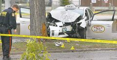 Police investigate the crash that killed a passenger and critically injured a cab driver.