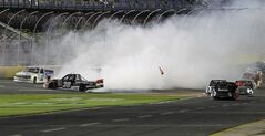 Ron Hornaday Jr (30) spins as trucks drive down pit road to avoid him during the NASCAR Trucks series auto race at Charlotte Motor Speedway in Concord, N.C., Friday, May 16, 2014. (AP Photo/Terry Renna)