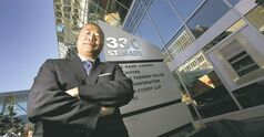 Ken Yee stands in front of one of two downtown buildings his firm, Cushman & Wakefield, and  TD Securities  recently sold.
