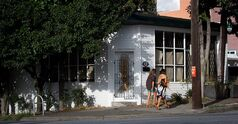 Two women walk past the former site of a restaurant at 305 Alexander Street in Vancouver, B.C., on Saturday September 21, 2013. THE CANADIAN PRESS/Darryl Dyck