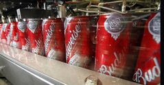 In this March 2, 2011 photo, Budweiser cans run through a filling machine at the Anheuser-Busch brewery in Los Angeles. THE CANADIAN PRESS/AP, Reed Saxon