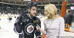 Sara Orlesky does a pregame interview with Tanner Glass prior to game against the San Jose Sharks Thursday.