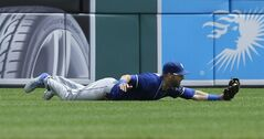 Kansas City Royals left fielder Alex Gordon catches the fly out hit by Detroit Tigers' J.D. Martinez during the fourth inning of a baseball game in Detroit, Wednesday, June 18, 2014. (AP Photo/Carlos Osorio)