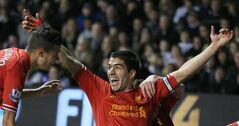 Liverpool's Luis Suarez celebrates after scoring the opening goal during the English Premier League soccer match between Tottenham Hotspur and Liverpool at the White Hart Lane stadium in London, Sunday, Dec 15 2013. Liverpool won the game 5-0. (AP Photo/Alastair Grant)