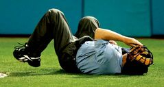 Home plate umpire Jerry Crawford falls to the ground after he was struck in the ribs by a foul ball in the seventh inning of a baseball game between the Florida Marlins and San Diego Padres, Tuesday, April 27, 2010 in Miami. (AP Photo/Wilfredo Lee)