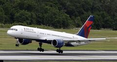A Delta Air Lines Boeing 757-232 lands in Tampa , Fla. on May 15, 2014. THE CANADIAN PRESS/AP, Chris O'Meara