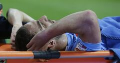 Napoli forward Gerardo Gonzalo Higuain of Argentina is carried away from the field after injuring during a Serie A soccer match between Inter Milan and Napoli, at the San Siro stadium in Milan, Italy, Saturday, April 26, 2014. (AP Photo/Luca Bruno)