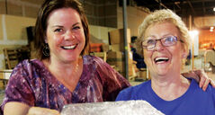 Volunteers Delayne Weeks and Roma Maconachie take a break from loading a container with medical supplies.