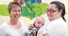 Nurse Kris Sneesby with baby Logan and his Mom, Chantal Gagnon, at the RSV clinic.