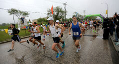 The leaders of the Full Marathon participants start at the University of Manitoba, Sunday, June 15, 2014.