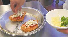 49.8 - rrc food column. Alex Wong prepares Chicken Parmigiana in the kitchen of the RRC School of Hospitality and Culinary Arts. Puts cheese on fried chicken. Keith F. M�����ller story Wayne Glowacki / Winnipeg Free Press Oct. 16 2013