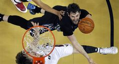 Minnesota Timberwolves power forward Kevin Love, top, goes to the basket against New Orleans Pelicans small forward Luke Babbitt (8) in the second half of an NBA basketball game in New Orleans, Friday, Feb. 7, 2014. The Pelicans won 98-91. (AP Photo/Gerald Herbert)