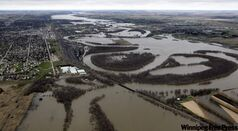 The Assiniboine River spreads far beyond its banks in Brandon Thursday. Its long-benign relationship with Manitoba's second-largest city is just a memory this spring.