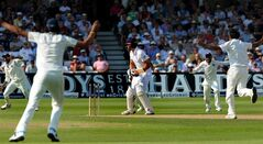 India players celebrate after England'sAlastair Cook is bowled by India's Mohammed Shami for 5 runs during day two of the first Test between England and India at Trent Bridge cricket ground, Nottingham, England, Thursday, July 10, 2014. (AP Photo/Rui Vieira)