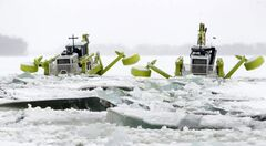 Amphibexes break ice on the Red River north of Selkirk on Feb. 21, 2012