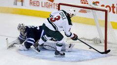 Winnipeg Jets goaltender Ondrej Pavelec can't stop Minnesota Wild's Charlie Coyle as he scores the game-winning goal in the shootout at the MTS Centre Saturday.