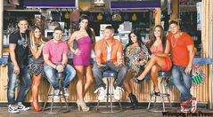 Yo... what're YOU lookin' at?: The well-tanned, tightly clothed cast of Jersey Shore begin their fifth season Thursday.