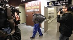 Winnipeg Blue Bomber Terrell Parker exits Investors Group Field with his belongings in a plastic bag Sunday, the day after the team played the last game of the season.