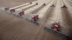 In this photo taken March 27, 2012, workers use combines to harvest soybeans in Tangara da Serra, Brazil. THE CANADIAN PRESS/AP, Andre Penner