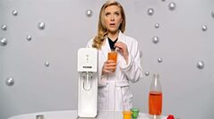 "This undated frame grab provided by SodaStream, shows the company's 2014 Super Bowl commercial. SodaStream's ad features ""Her"" actress Scarlett Johansson promoting its at-home soda maker and will run in the fourth quarter. The ad, which promotes the product as a healthier and less wasteful way to make soda, made waves ahead of the game when the company said it would delete it's last line, ""Sorry, Coke and Pepsi,"" at a request by Fox. (AP Photo/SodaStream)"