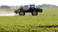 FILE - This July 11, 2013, file photo shows Blake Beckett of West Central Cooperative as he sprays a soybean field, in Granger, Iowa. Faced with tougher and more resistant weeds, corn and soybean farmers are anxiously awaiting government decisions on a new version of a popular herbicide _ and on genetically modified seeds to grow crops designed to resist it. The Environmental Protection Agency is expected to rule in the fall of 2014 on Dow AgroSciences' application to market Enlist, a new version of the 2,4-D herbicide that's been around since the 1940s.(AP Photo/Charlie Neibergall, File)
