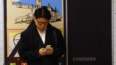 A man uses his mobile phone in Seoul, South Korea, Nov. 28, 2011. THE CANADIAN PRESS/AP, Lee Jin-man