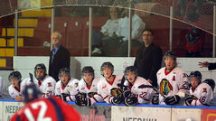 Members of the Neepawa Natives and head coach Bryant Perrier (right) look on from the bench during Wednesday night's MJHL game against the Dauphin Kings at the Yellowhead Centre in Neepawa.