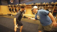 Mark Flood (left) and Jets massage therapist Al Pritchard share a handshake.