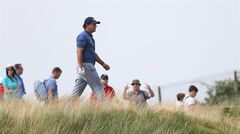 Phil Mickelson of the US walks along the 12th fairway during the second day of the British Open Golf championship at the Royal Liverpool golf club, Hoylake, England, Friday July 18, 2014. (AP Photo/Scott Heppell)