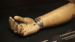In this photo taken Wednesday, May 21, 2014, a prosthetic right arm issued to a wounded American soldier is on display at the National World War I Museum at Liberty Memorial in Kansas City, Mo. The museum focuses on the century-old Great War. (AP Photo/Charlie Riedel)