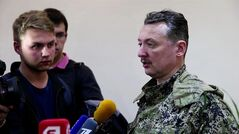 This image taken from Associated Press video shows Igor Strelkov, military commander of pro-Russian militias in Slovyansk talking to journalists in Slovyansk, Ukraine, Sunday, April 27, 2014. Strelkov has been identified as a Russian security services operative by Ukraine's government. In what appeared to be a closely vetted interview to Russian media, Strelkov did not directly deny the accusation, saying the uprising in Ukraine was being carried out by opponents of the