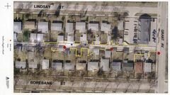 A map entered into evidence at the officers' trial shows the back lane between Lindsay Street and  Borebank Street near Grant Avenue. The red dots indicate lamp posts, the blue dots indicate shell casings, and the green dot indicates the location of Kristofe Fournier's arrest.
