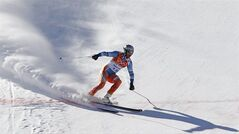 Norway's Aksel Lund Svindal comes to a halt at the end of a men's downhill training run for the Sochi 2014 Winter Olympics, Saturday, Feb. 8, 2014, in Krasnaya Polyana, Russia. (AP Photo/Christophe Ena)