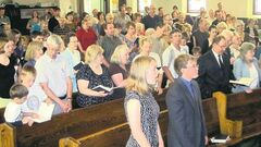 The congregation sings a hymn at the Home Street Mennonite Church in Winnipeg.