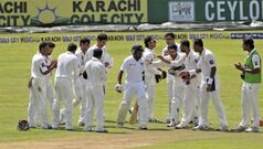 Pakistan players greet Sri Lankan batsman Mahela Jayawardene, center, as he walks into bat on the first day of the second test cricket match in Colombo, Sri Lanka, Thursday, Aug.14, 2014.Former captain Jayawardene is the center of attention for the match, playing in his 149th and final test. (AP Photo/Eranga Jayawardena)