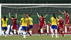China's Zhu Zhang (11), Jiali Tang (10), Mengwen Li (13) and Siqi Lyu (5) celebrate a goal against Brazil during second half action at the FIFA U-20 Women's World Cup in Edmonton, Alta., on Tuesday August 5, 2014. THE CANADIAN PRESS/Jason Franson