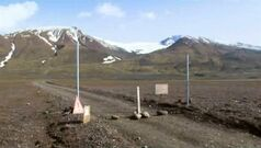 In an in an image from an Aug. 19, 2014 video, a sign is posted on the road next to Bardarbunga, a subglacial stratovolcano located under Iceland's largest glacier. On Saturday, Aug. 23, 2014, Iceland closed airspace over the Bardarbunga volcano on Saturday after the Meteorological Office said an eruption had begun under the ice of Europe's largest glacier. The English portion of the sign reads,