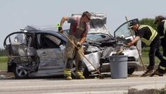 Tow truck and firefighters clean up debris after a four-vehicle crash on the Perimeter Highway at McGillivray Boulevard late Wednesday morning. Three people were sent to hospital; their condition is not known.