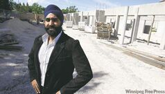 Karampaul Sandhu of Sandhu Developments Inc. in front of the 24-unit Sands on Leila apartment-style condo project under construction at 680 Mathias Ave.