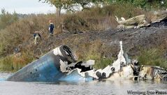 Rescuers at the site of the jet wreckage near the city of Yaroslavl, on the Volga River, about 240 kilometres northeast of Moscow Wednesday.