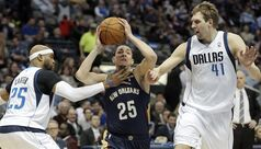 New Orleans Pelicans' guard Austin Rivers, center, battles Dallas Mavericks' Vince Carter, left, and Dirk Nowitzki (41) for space during the first half of an NBA basketball game on Wednesday, Feb. 26, 2014, in Dallas. (AP Photo/Brandon Wade)