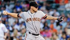 San Francisco Giants starting pitcher Jake Peavy delivers in the first inning of a baseball game against the Chicago Cubs on Wednesday, August 20, 2014, in Chicago. (AP Photo/Matt Marton)