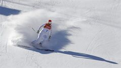 United States' Marco Sullivan comes to a halt at the end of a men's downhill training run for the Sochi 2014 Winter Olympics, Saturday, Feb. 8, 2014, in Krasnaya Polyana, Russia. (AP Photo/Christophe Ena)