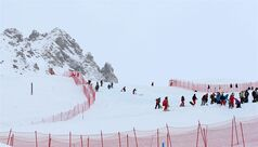Course workers check the snow prior to the cancellation of an alpine ski, women's World Cup downhill training due to the bad weather conditions, in Val d'Isere, France, Friday, Dec. 20, 2013. (AP Photo/Giovanni Auletta)