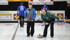 Carberry's Max Vankommer (left) helps Winnipeg's Kevin Thompson guide a rock inbound for the house at a community bonspiel held in Carberry annually.