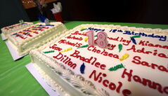Birthday cakes line a table at a local CFS celebration.
