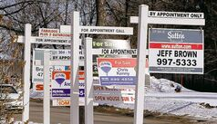 Signs along west Taylor Avenue  advertise homes for sale.