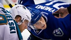 Vancouver Canucks' Mason Raymond right, and San Jose Sharks' Joe Pavelski wait for linesman Ryan Galloway to drop the puck as they face off during the first period of an NHL hockey game in Vancouver, B.C., on Tuesday March 5, 2013. THE CANADIAN PRESS/Darryl Dyck